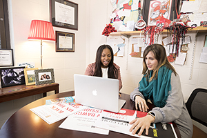 Athens-Clarke County high school student works with University of Georgia staff member to create marketing materials